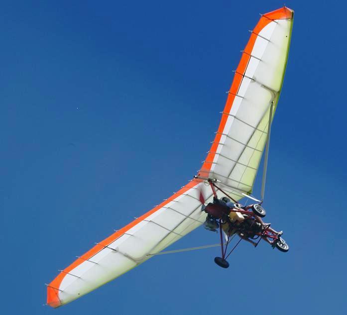 Vol pendulaire au dessus du lagon de St François devant les villas Boubou